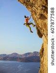 female rock climber falling off ... | Shutterstock . vector #607877588