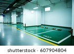 parking lot in an underground... | Shutterstock . vector #607904804
