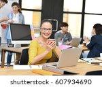 senior businesswoman smiling at ... | Shutterstock . vector #607934690