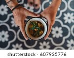 hands of young woman holding a... | Shutterstock . vector #607935776