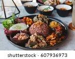 nasi campur  asian dish made of ...   Shutterstock . vector #607936973