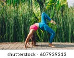 young woman practicing yoga... | Shutterstock . vector #607939313