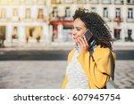 beautiful brazilian curly woman ... | Shutterstock . vector #607945754