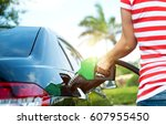 hand refilling the car with... | Shutterstock . vector #607955450