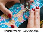 female hands sewing on old... | Shutterstock . vector #607956506
