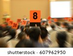 people holding auction paddle... | Shutterstock . vector #607962950