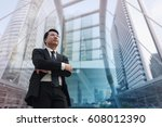 confident asian businessman... | Shutterstock . vector #608012390
