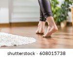 Floor Heating. Young Woman...