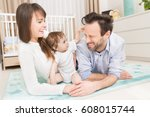 happy parents playing with your ... | Shutterstock . vector #608015744