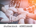 a group of young people hold... | Shutterstock . vector #608016668