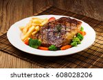grilled beef steak served with... | Shutterstock . vector #608028206