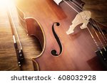 Cello on wood background with...