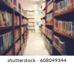 de focus shelf of books in... | Shutterstock . vector #608049344