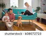 father sitting on the floor and ... | Shutterstock . vector #608072723