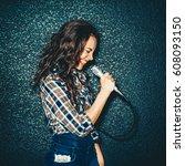 crazy girl holding microphone... | Shutterstock . vector #608093150