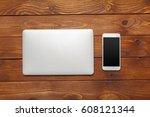 laptop  notebook on work wooden ...   Shutterstock . vector #608121344