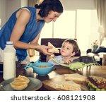 family eating breakfast... | Shutterstock . vector #608121908