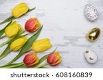 colored eggs and tulips over... | Shutterstock . vector #608160839