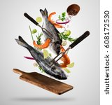 flying raw whole bream fish and ... | Shutterstock . vector #608172530
