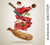 flying pieces of raw beef... | Shutterstock . vector #608172539