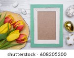 colored eggs and tulips over... | Shutterstock . vector #608205200