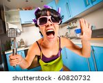 crazy housewife in an interior of the kitchen - stock photo