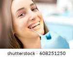 putting dental braces to the... | Shutterstock . vector #608251250