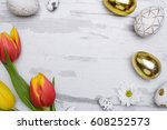 colored eggs and tulips over... | Shutterstock . vector #608252573