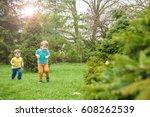 kids on easter egg hunt in... | Shutterstock . vector #608262539