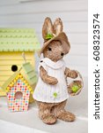 easter bunny in the house   Shutterstock . vector #608323574