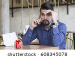 young man at cafe with gift on... | Shutterstock . vector #608345078