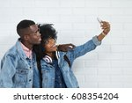 young african couple taking... | Shutterstock . vector #608354204
