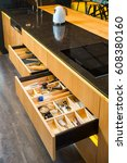 Stock photo kitchen furniture with open drawers 608380160