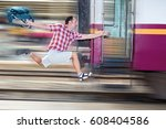tourist with bag running behind ... | Shutterstock . vector #608404586