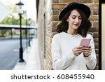 Woman Using Smart Phone...
