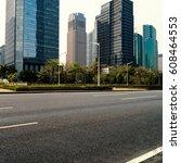 empty asphalt road of a modern... | Shutterstock . vector #608464553