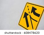 Small photo of merge traffic sign against sky background