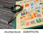 collecting postage stamps.... | Shutterstock . vector #608494196