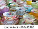 Pretty pastel tea cups in row   ...
