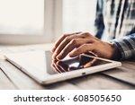 man using digital tablet... | Shutterstock . vector #608505650
