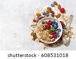 homemade muesli with yogurt and ... | Shutterstock . vector #608531018