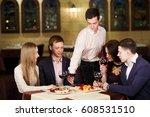friends at a restaurant... | Shutterstock . vector #608531510