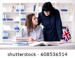 young foreign student during... | Shutterstock . vector #608536514