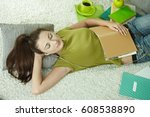 young female student takes a...   Shutterstock . vector #608538890
