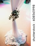 Small photo of beautiful white and claret flowers decorate the wedding arch
