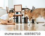 boy and beagle dog play with... | Shutterstock . vector #608580710