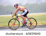 WASHINGTON - SEPTEMBER 12: An athlete cycles in the Nation's Triathlon on September 12, 2010 in Washington, D.C. - stock photo