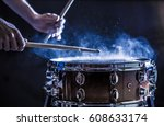man plays musical percussion... | Shutterstock . vector #608633174