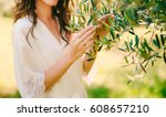 olive branch in female hands.... | Shutterstock . vector #608657210
