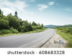 road along mountain forest in... | Shutterstock . vector #608683328